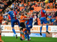 Dundee United's Pavol Safranko (C) rose highest to head the Terrors in front.