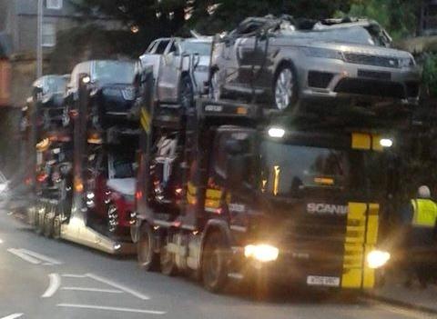 The damaged car transporter.
