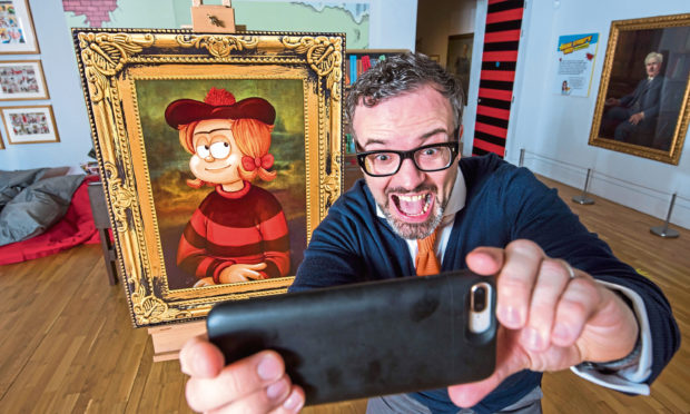 Mike Stirling with a portrait of Minnie the Minx at the McManus.
