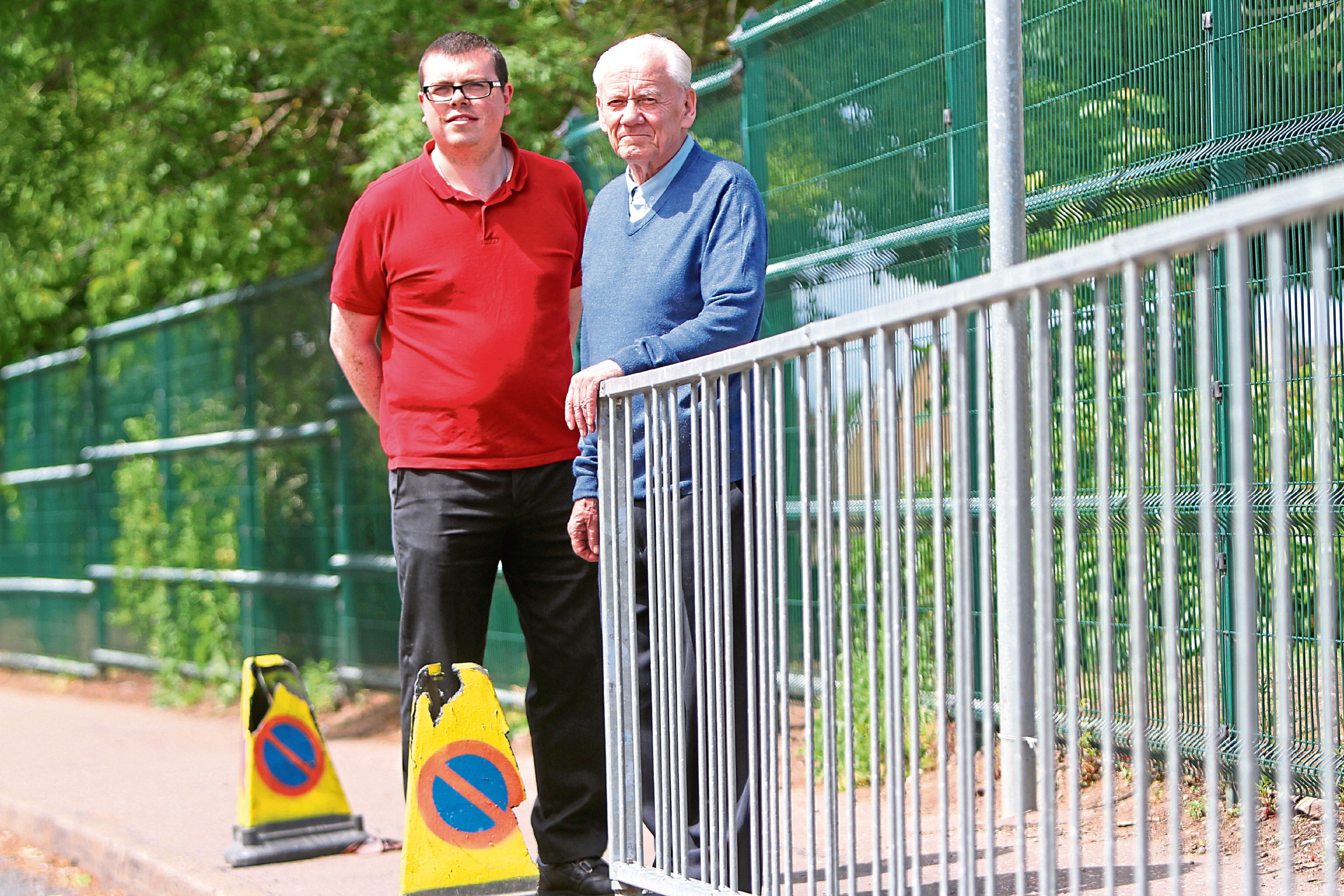 Simon Redmond and Ron Neave outside the school.
