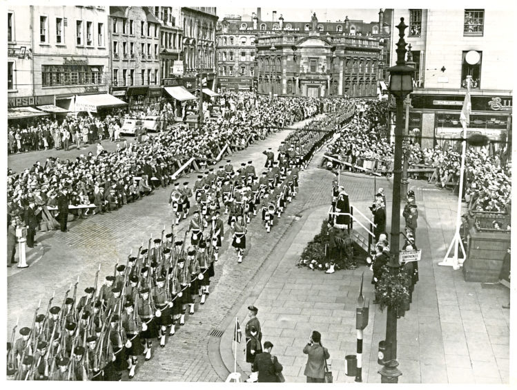 A Black Watch march takes place in Dundee city centre in 1954