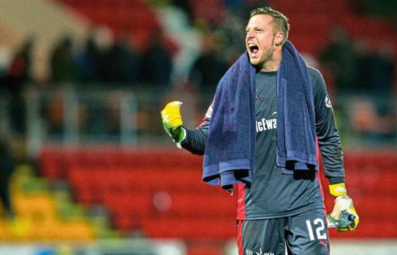 Elliott Parish in goal.