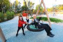 Pictured is Lord Provost Ian Borthwick getting a push from youngsters Kaydee Scrimgeour and Emmanuel Modrzyk.
