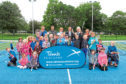 Young tennis players and coaches at Baxter Park.