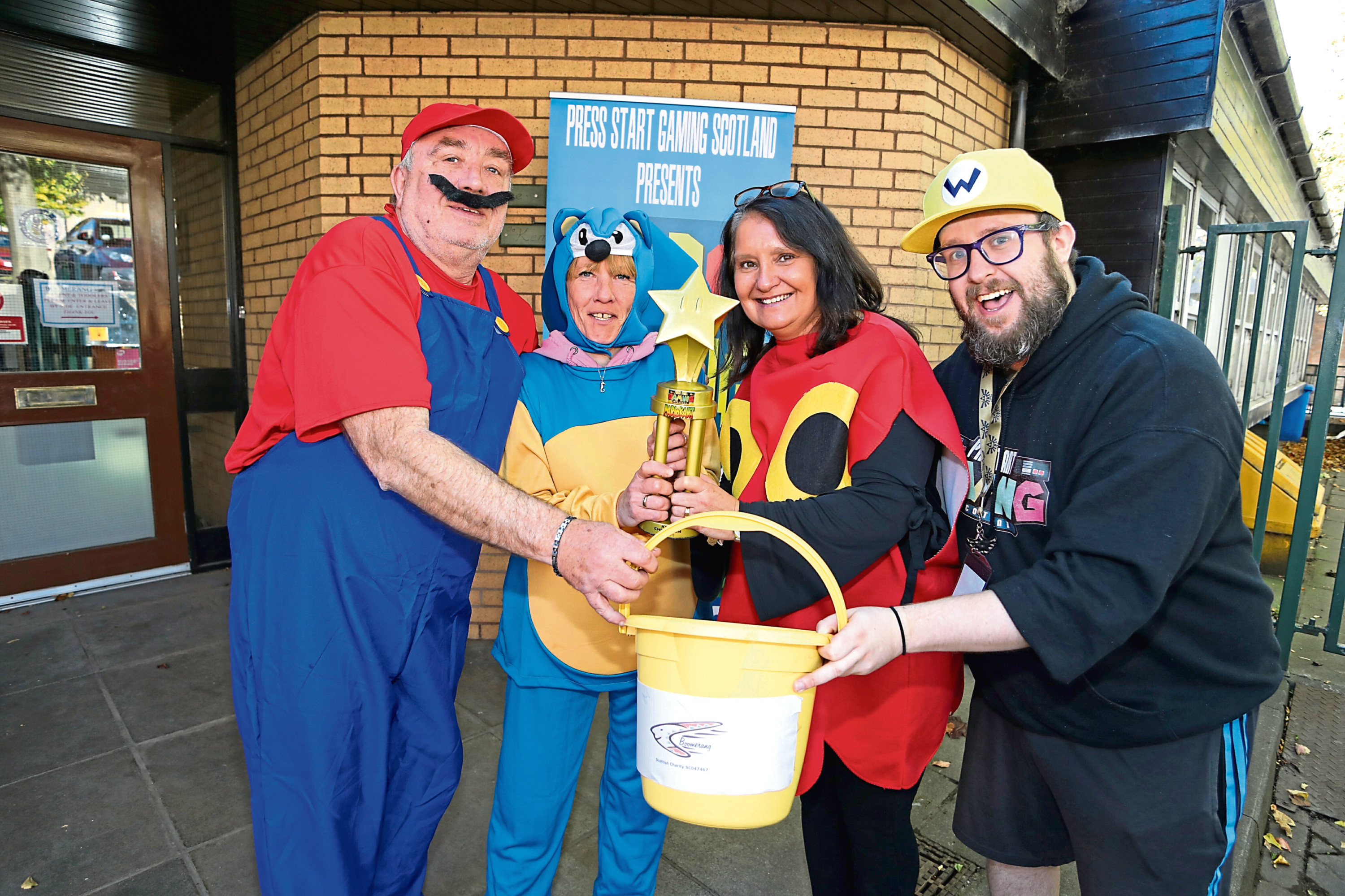 From left, Boomerang centre manager Neil Ellis, Lynne Christie, Alison Carr and event organiser Kevin Purdie.