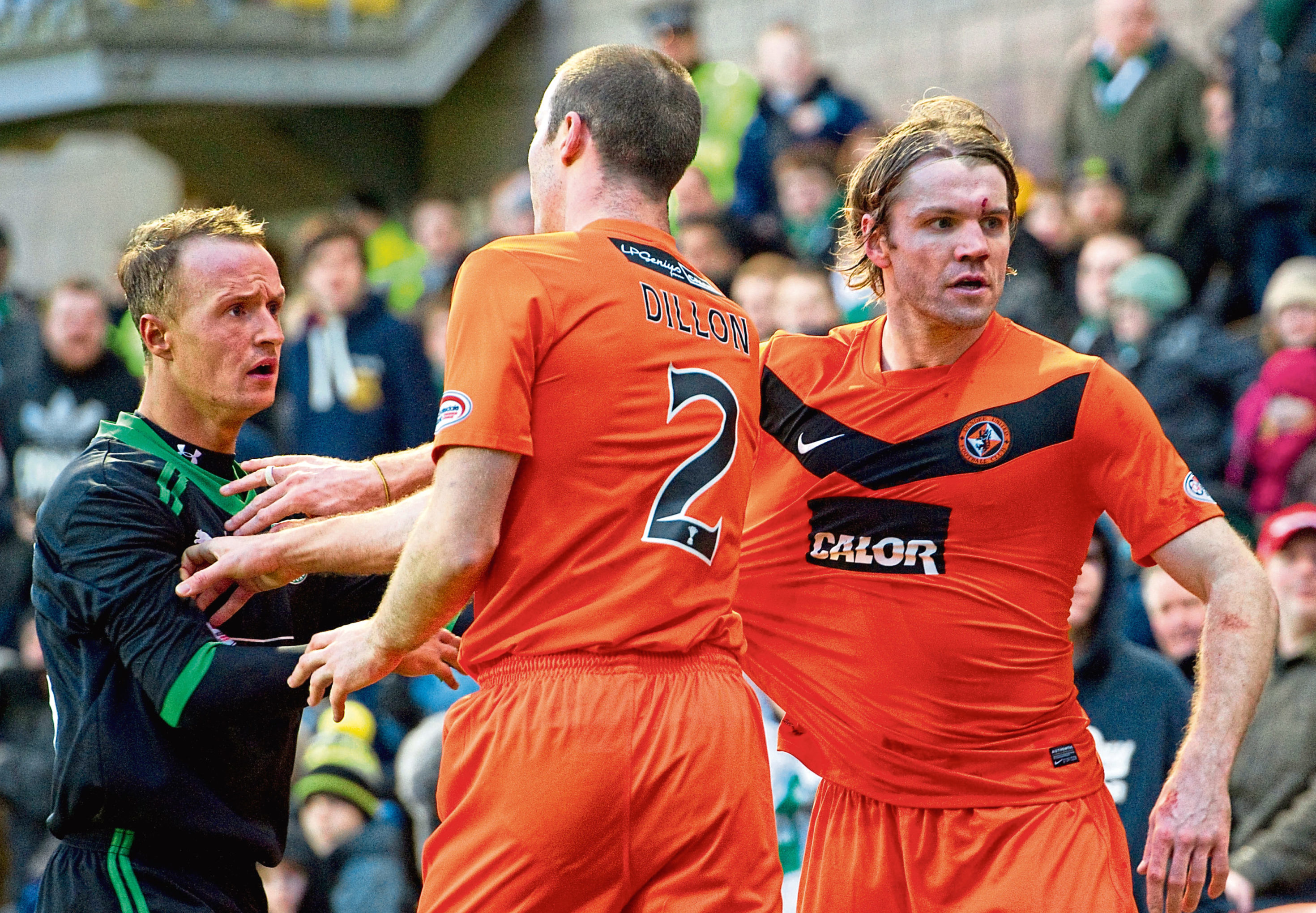 Sean Dillon and Robbie Neilson teamed up in Dundee United's defence when Craig Levein was boss at Tannadice. Above sees the pair involved with then Hibs forward Leigh Griffiths.