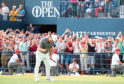 The Open winner Francesco Molinari celebrates his birdie on the 18th