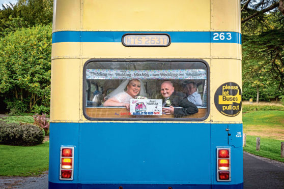 Dawn and Kevin Lowden aboard their wedding bus.