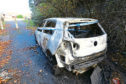The burnt-out car just off the Perth Road, near Windsor Street, in Dundee
