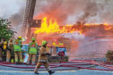 Firefighters at Hilltown Indoor Market last month