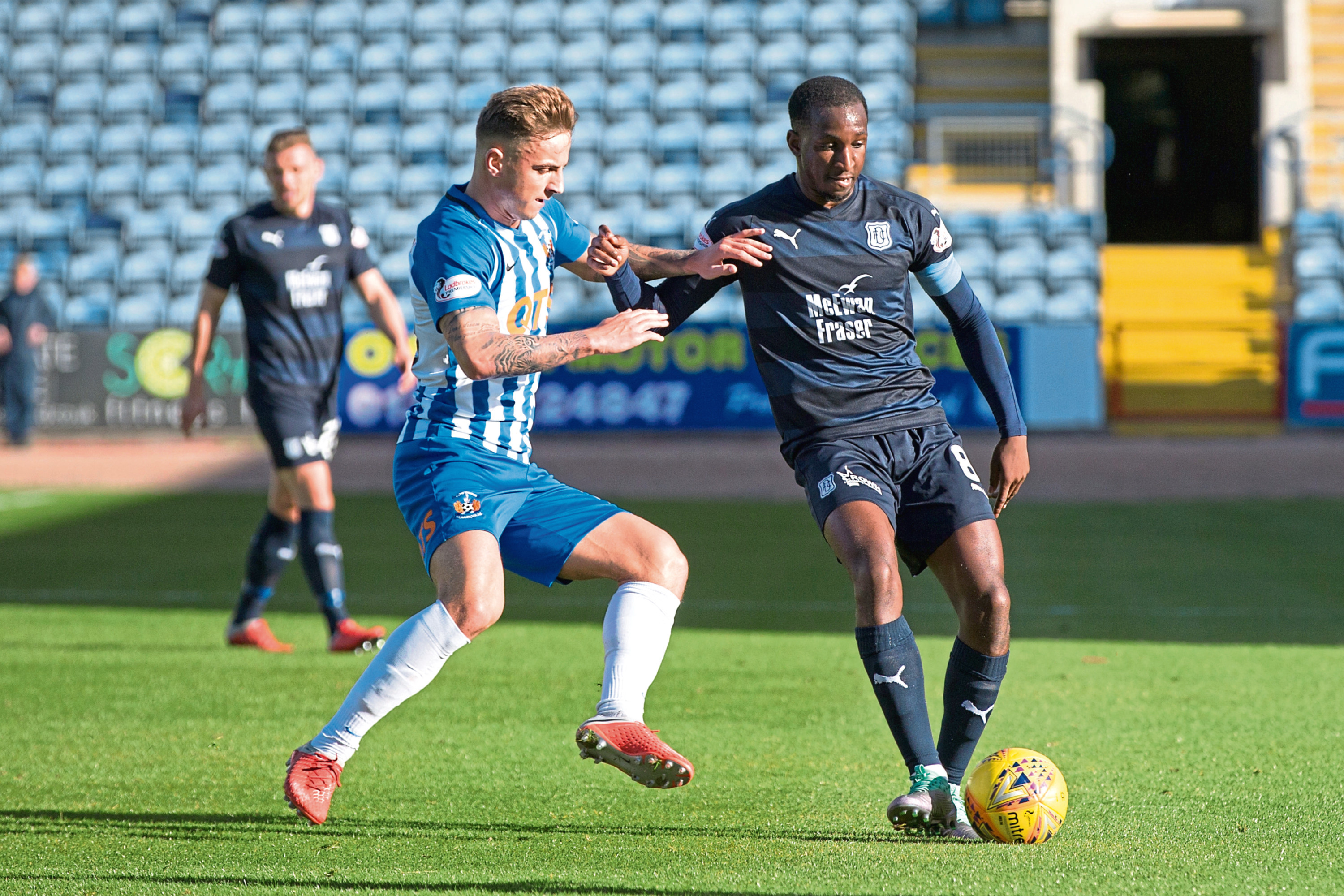 Dundee's Glen Kamara challenges for the ball with Eamonn Brophy of Kilmarnock