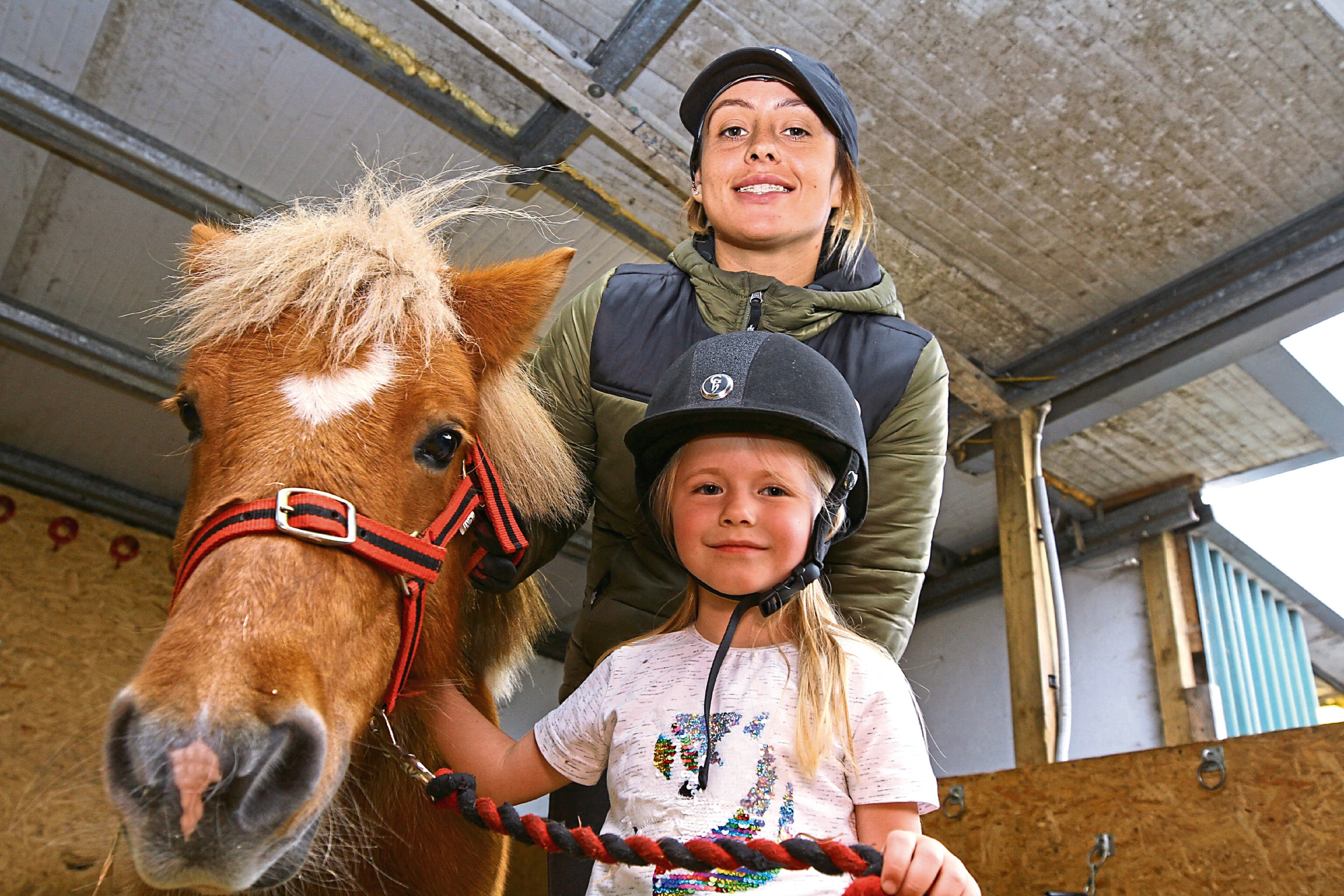 Daisy is pictured at Claverhouse Equestrian Centre with Reilly the Shetland pony and instructor Rachel Rosscraig