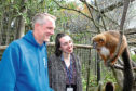 Reporter Claire Hutchison and course leader Chris Ditchburn in the red-bellied lemurs' enclosure