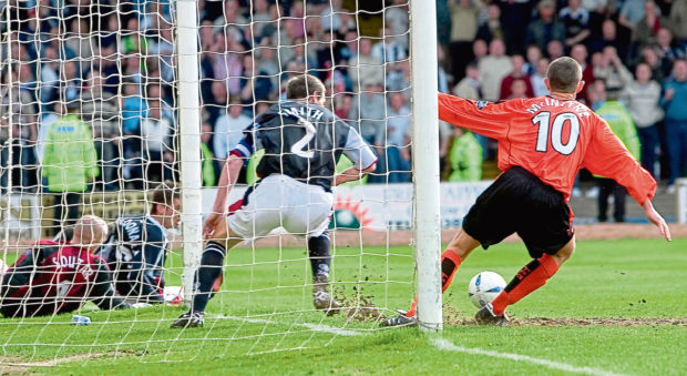 Jim McIntyre (right) scores the winning goal for Dundee United in the Dundee derby of April 2005