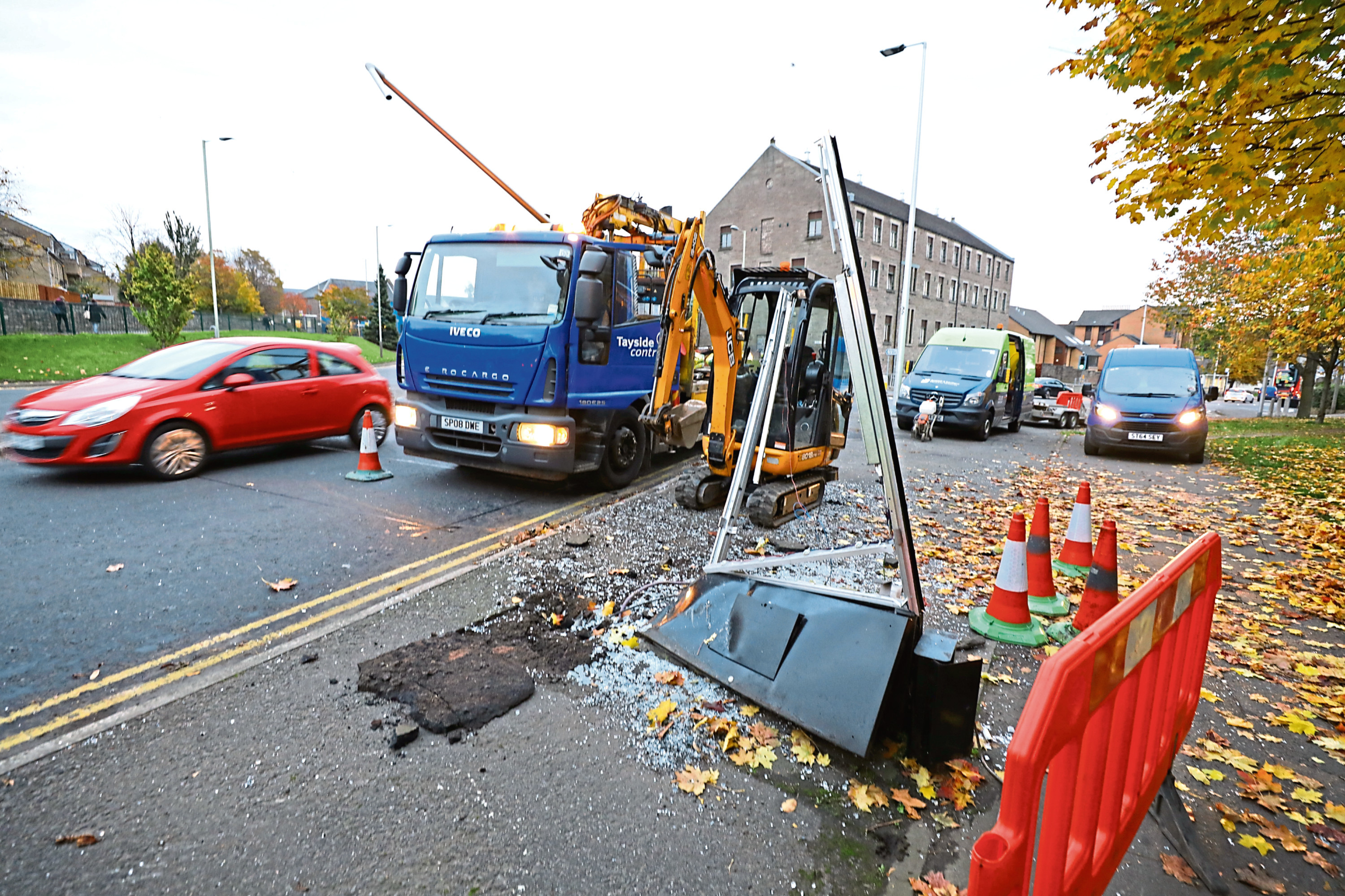 The car collided with this road sign and a lamppost nearby.