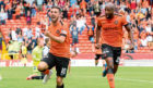 Dundee United's Nicky Clark (left) celebrates making it 1-0 against Dunfermline in a game United eventually lost 3-2