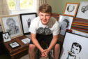 Caelan Smith with his artwork before the auction