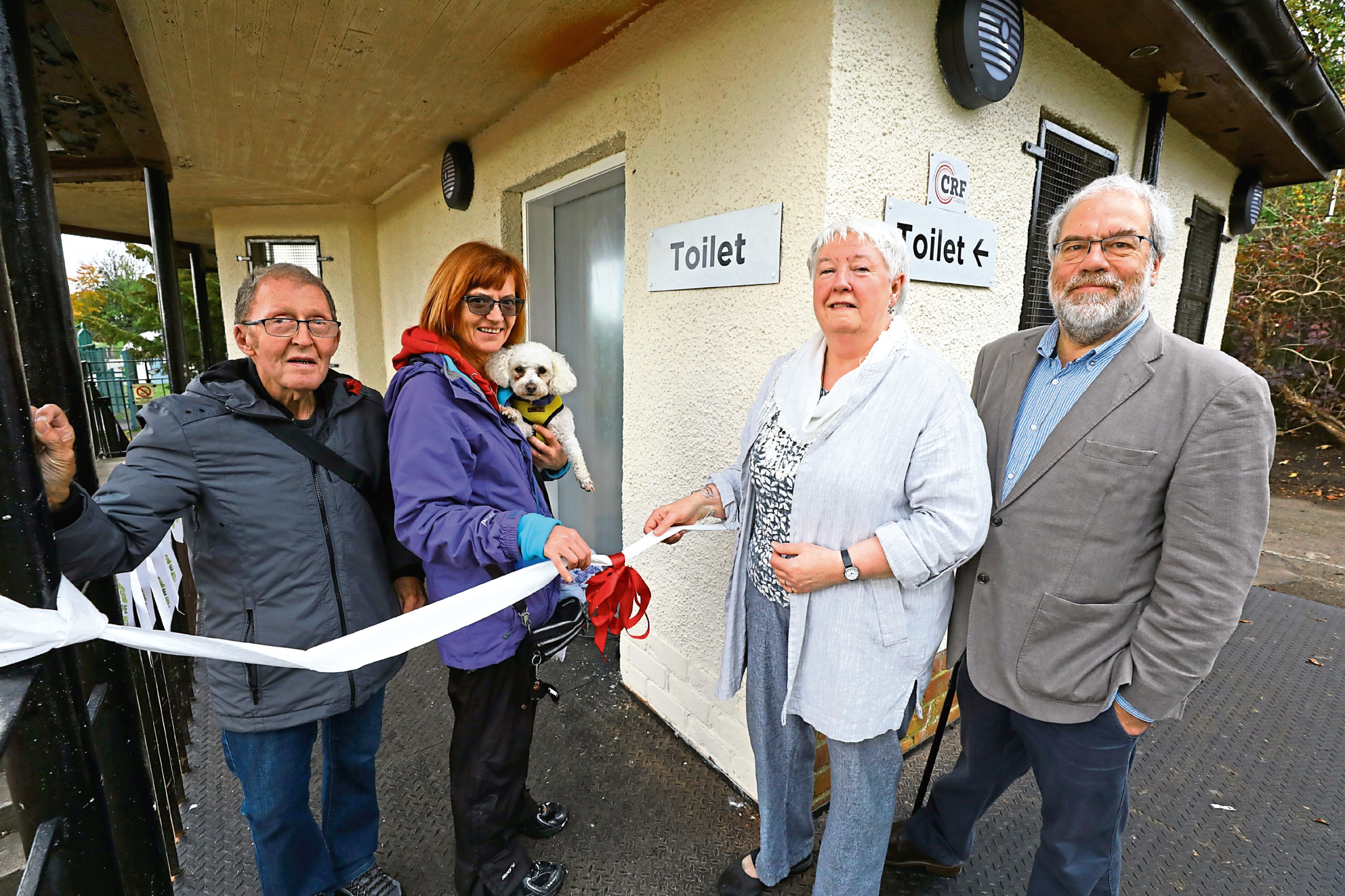 Pictured at the opening of the new loos are, from left, John Milligan of Coldside Community Regeneration Forum, local resident Carole Zabowka with her dog Nelson, Dorothy, and Steve Connelly, treasurer of the Friends of Dudhope Park