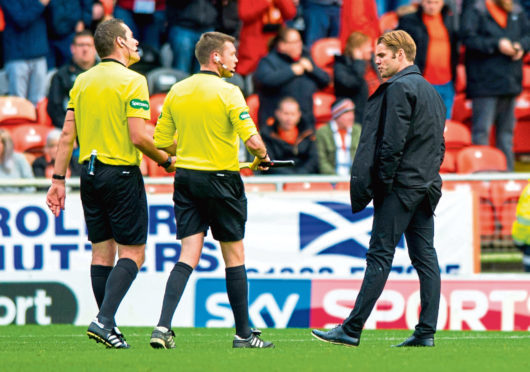 Dundee United manager Robbie Neilson having a word with the officials at half-time against Inverness at Tannadice