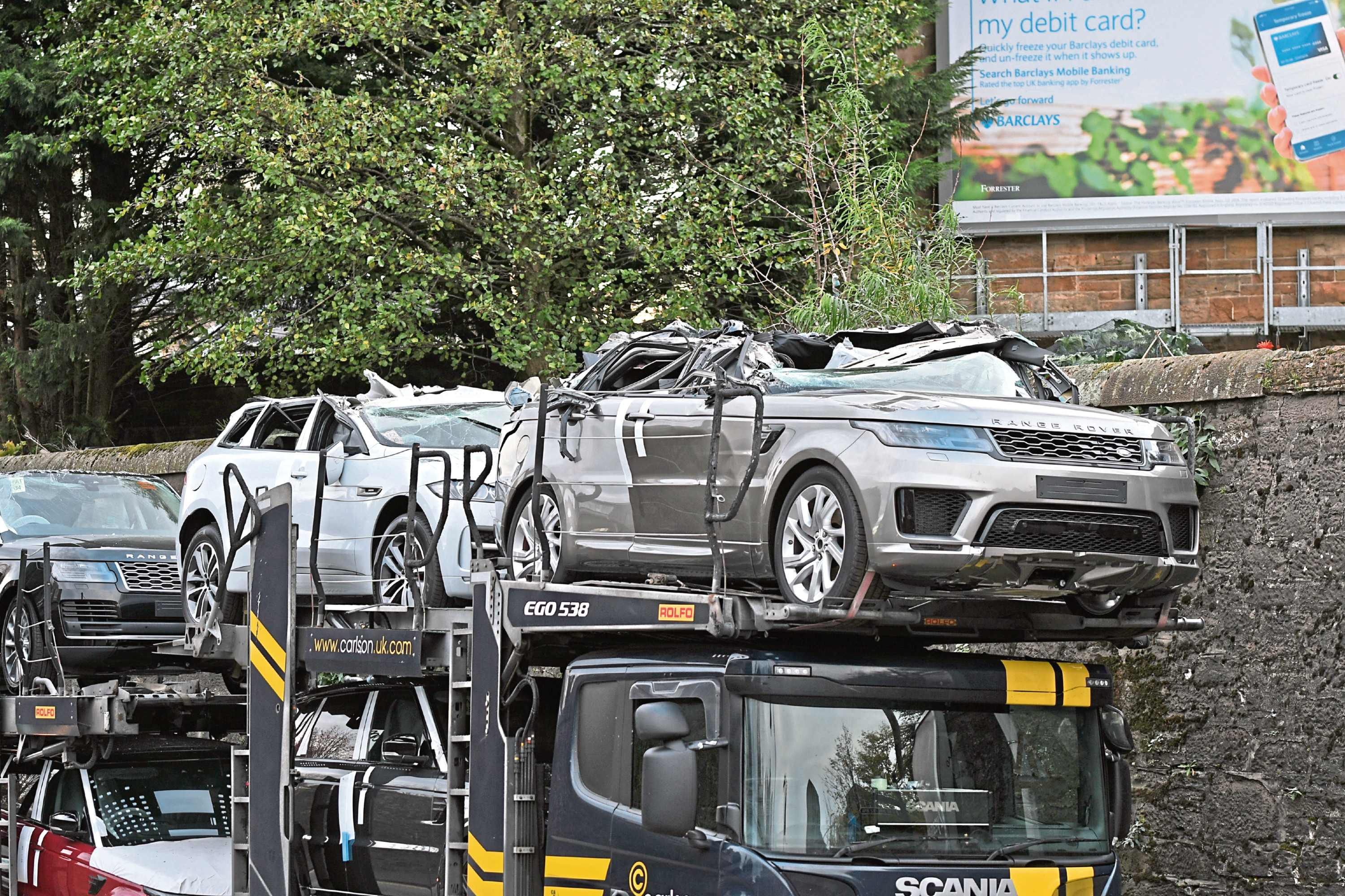 One of the damaged cars on the transporter.