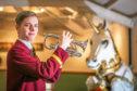Picture shows Harris Academy pupil Rael Watt, 18, with the cornet on HMS Unicorn