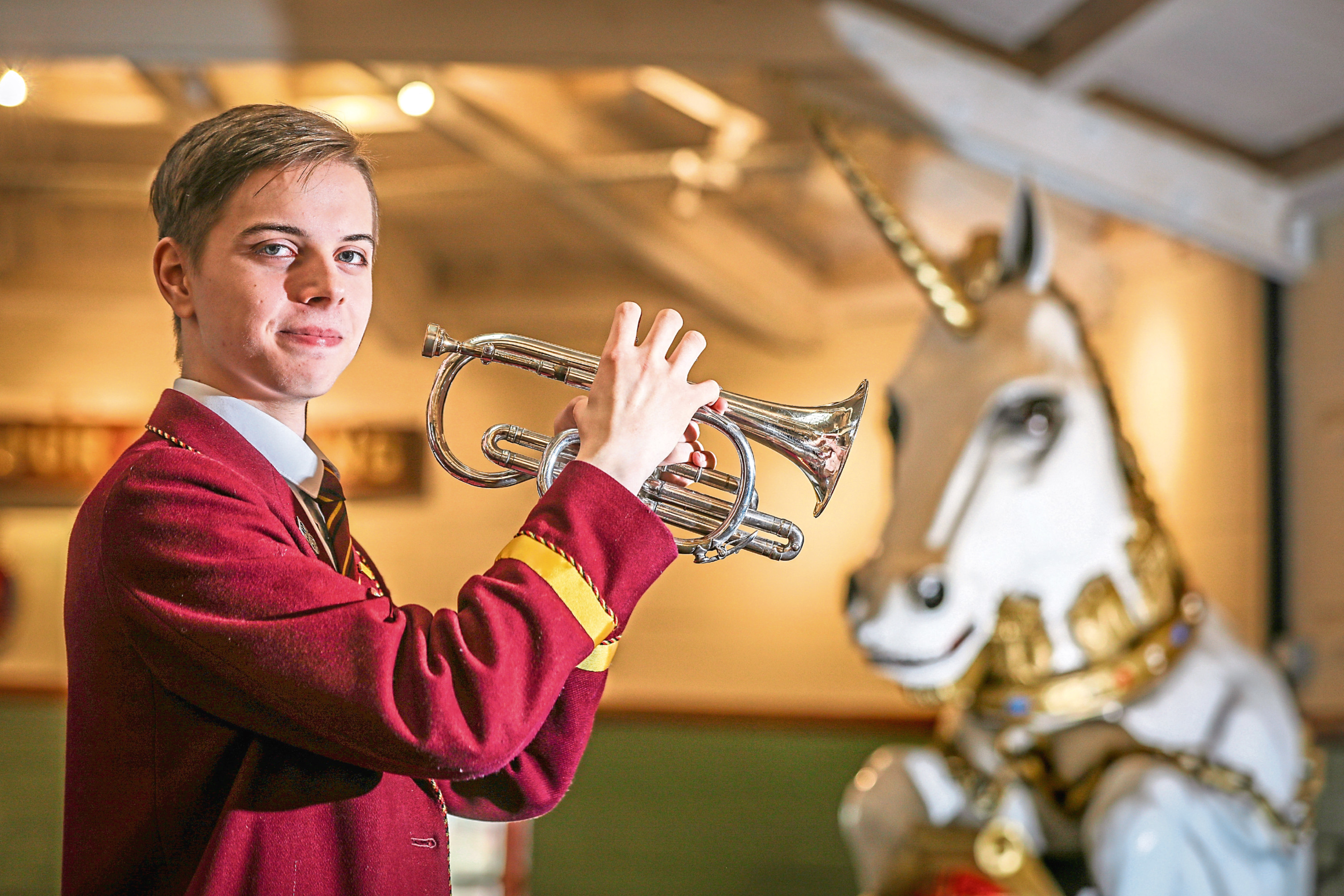 Picture shows Harris Academy pupil Rael Watt, 18, with the cornet on HMS Unicorn