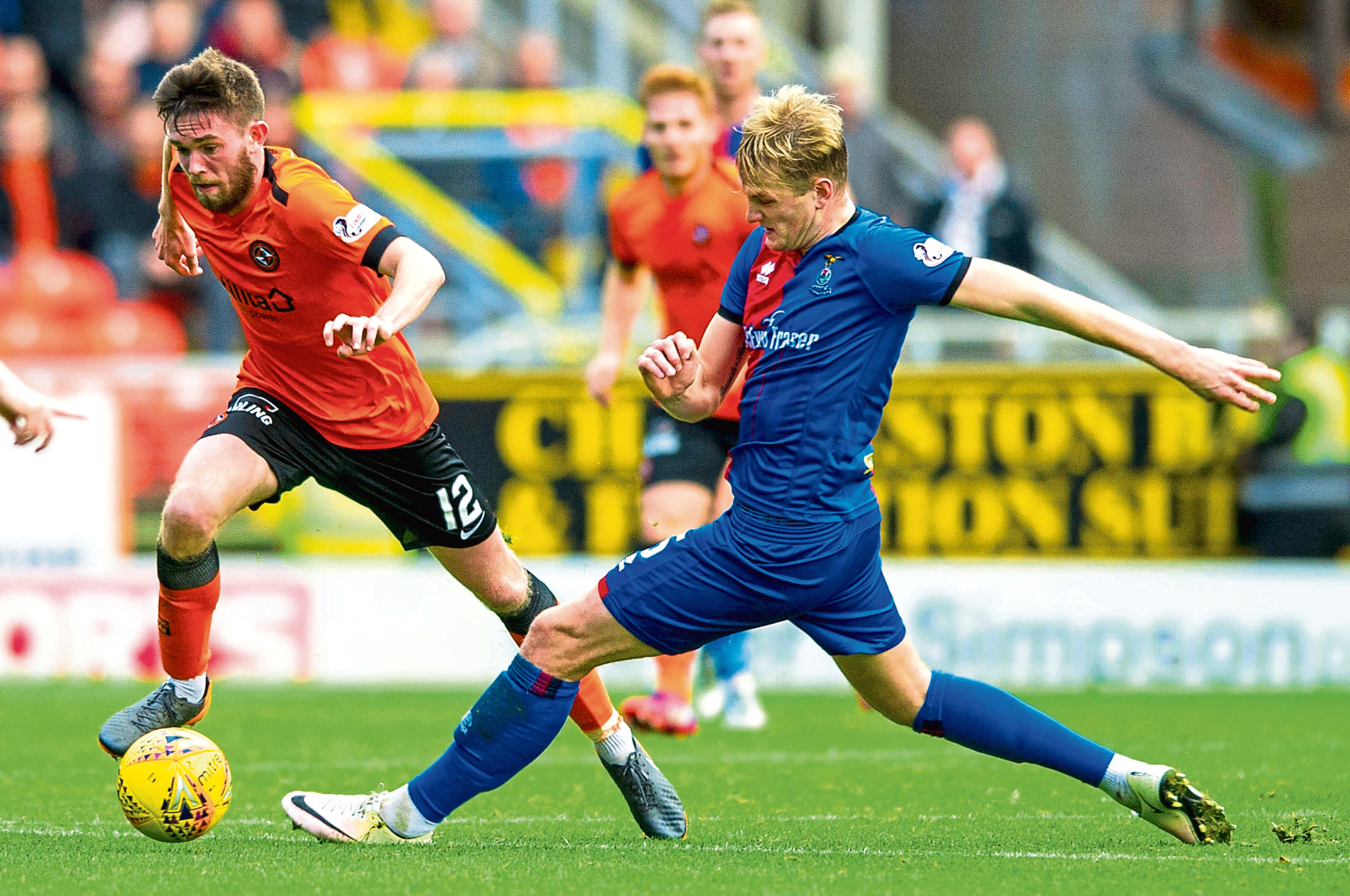 Sam Stanton skips past former United man Coll Donaldson in the weekend clash against Inverness