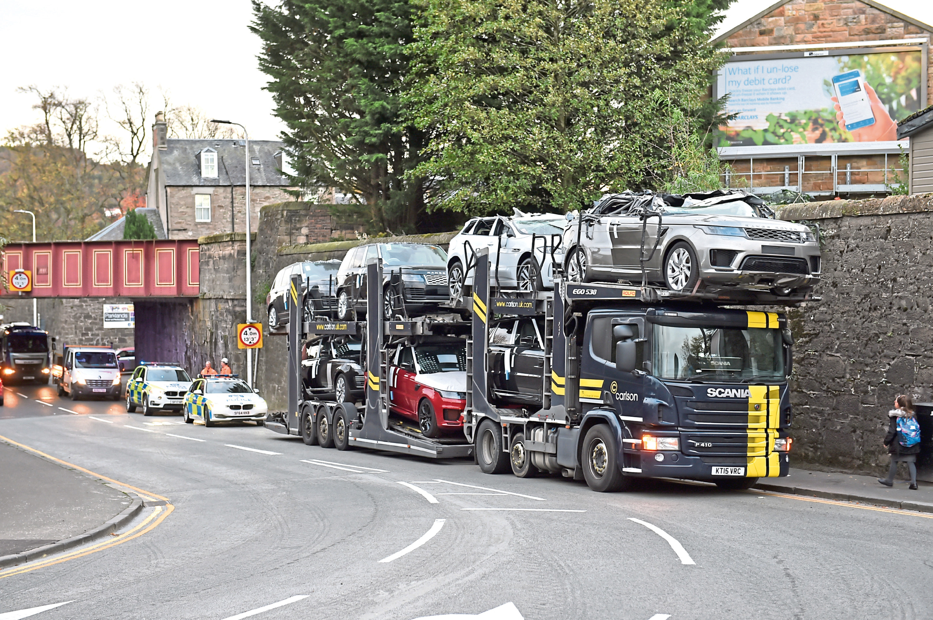 The car transporter with the damaged vehicles above the driver's cab