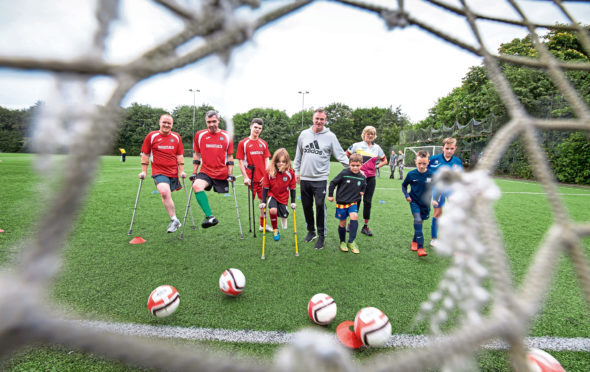 Northern Ireland manager Michael O'Neill puts Scots amputee footballers through their paces