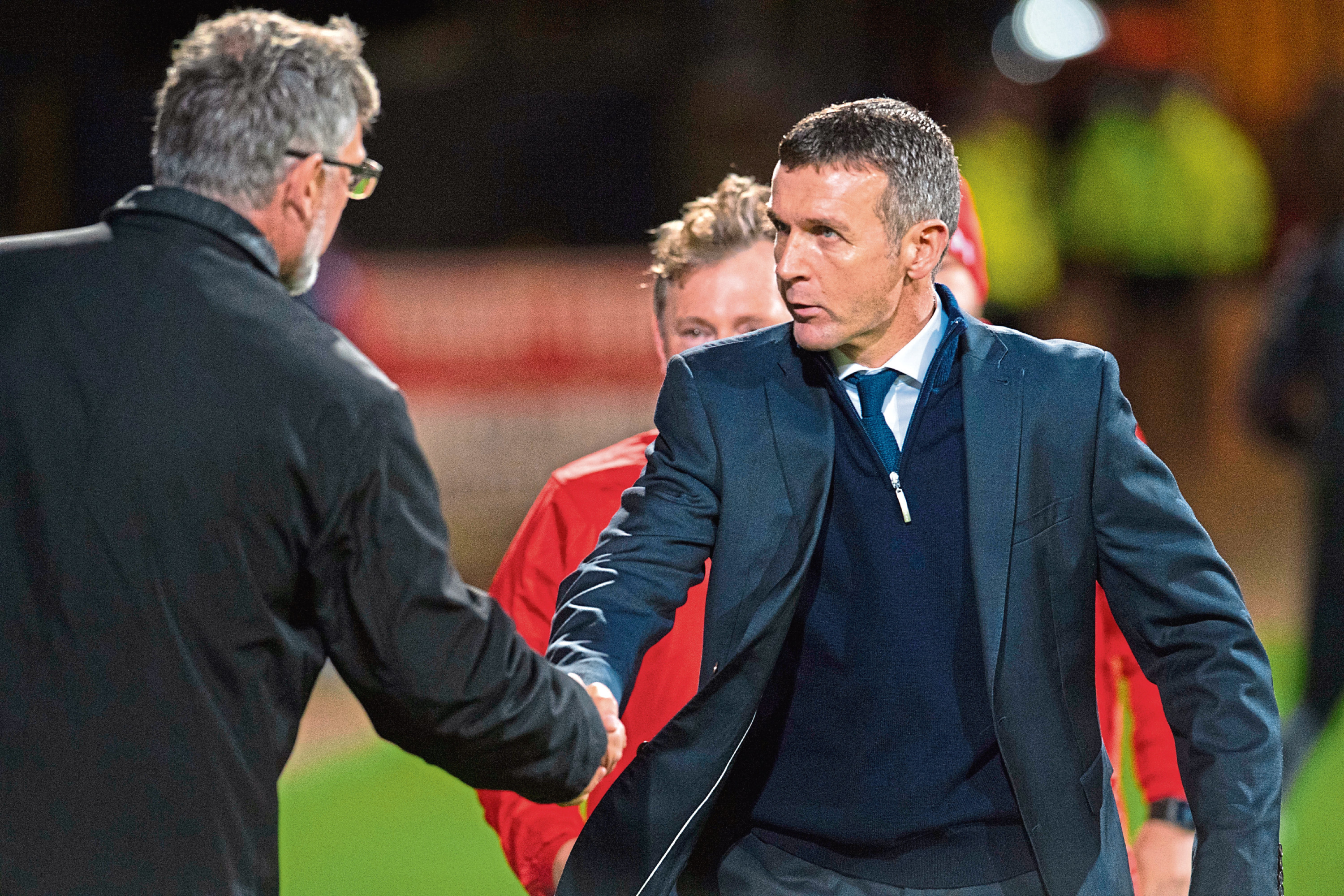 Dundee gaffer Jim McIntyre (right) faces the biggest test of his managerial career in turning Dundee's season around