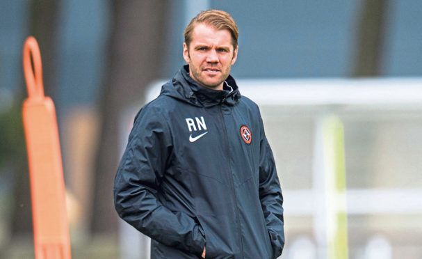 Dundee United manager Robbie Neilson takes training at St Andrews