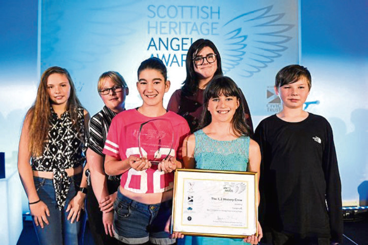 The group with their award