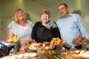 Picture shows (from left) the convener of Ardler Complex Fiona Cook, catering assistant Jackie Simpson and cafe manager Sturrock Ritchie