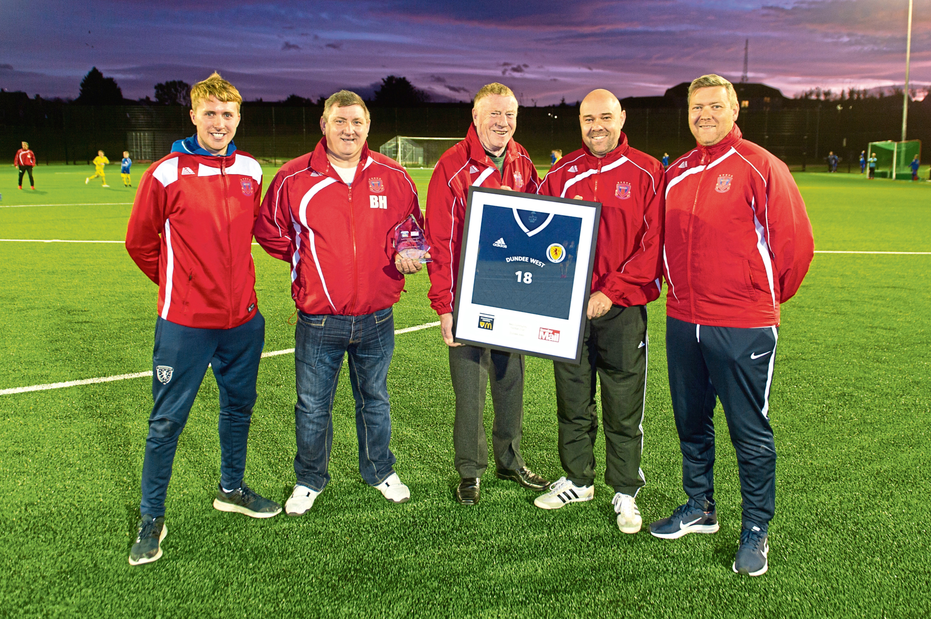 Dundee West Football Club's Tam McCabe (club development officer), Norman Low (vice-president), Jim Hunter (president), Paul Gibson (secretary) and Ross Laing (assistant secretary) with their accolades