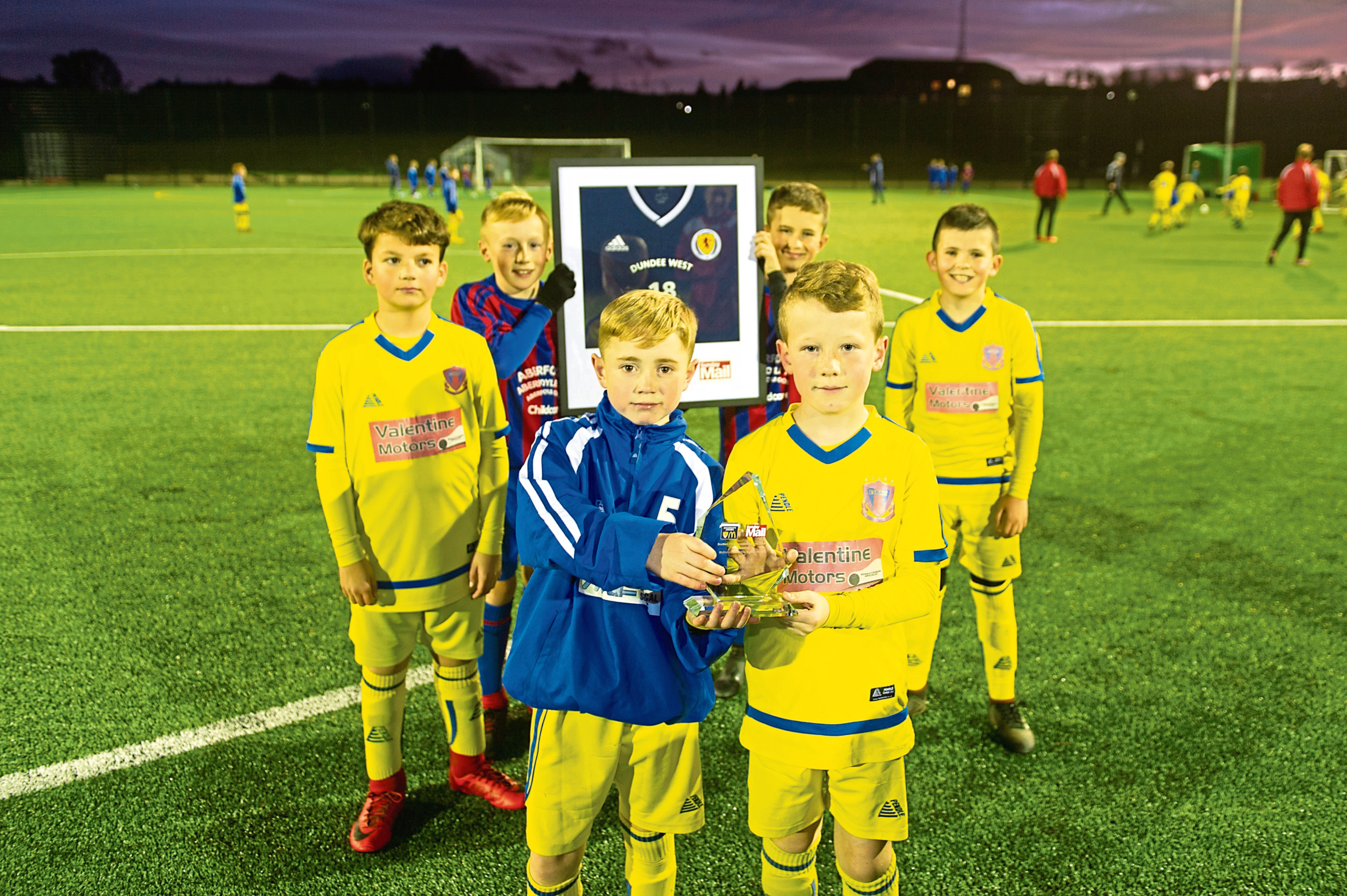 Back row (left-right): Ellis Muir, Josh Myszok, Tyler Smith and Mason Breen and front (l-r): Owen Godfrey and Aiden Mullady with Dundee West's awards at the youngsters training at Baldragon Academy on Wednesday night