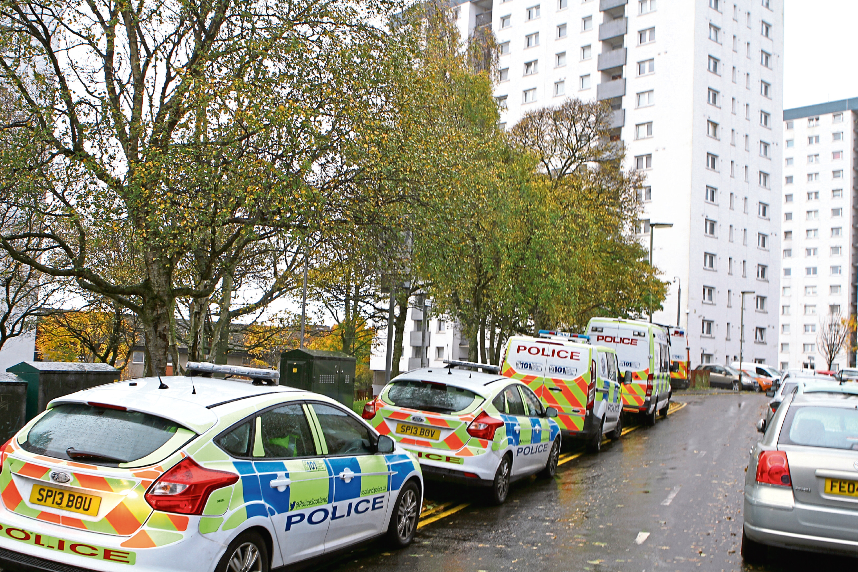 Police vehicles outside Hilltown Court as day two of Operational Fundamental is carried out