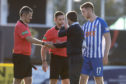 Dundee manager Neil McCann remonstrates with referee Steven McLean at full time
