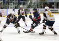 Dundee Stars' Francois Bouchard is outnumbered three-to-one as he attacks the Guildford Flames defence during the game at Dundee Ice Arena.