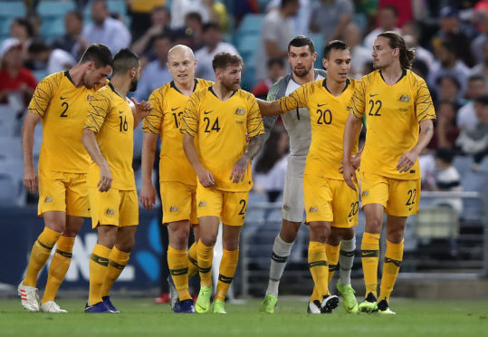 Martin Boyle is congratulated after scoring his teams first goal for Australia
