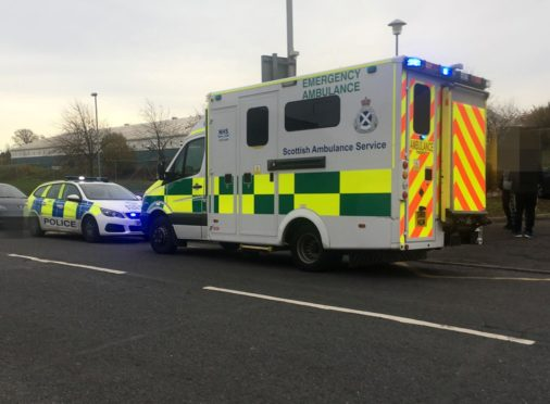 Police and ambulance outside the school following the incident.