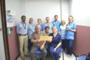 Jim hands over the donation to Ward 33 staff