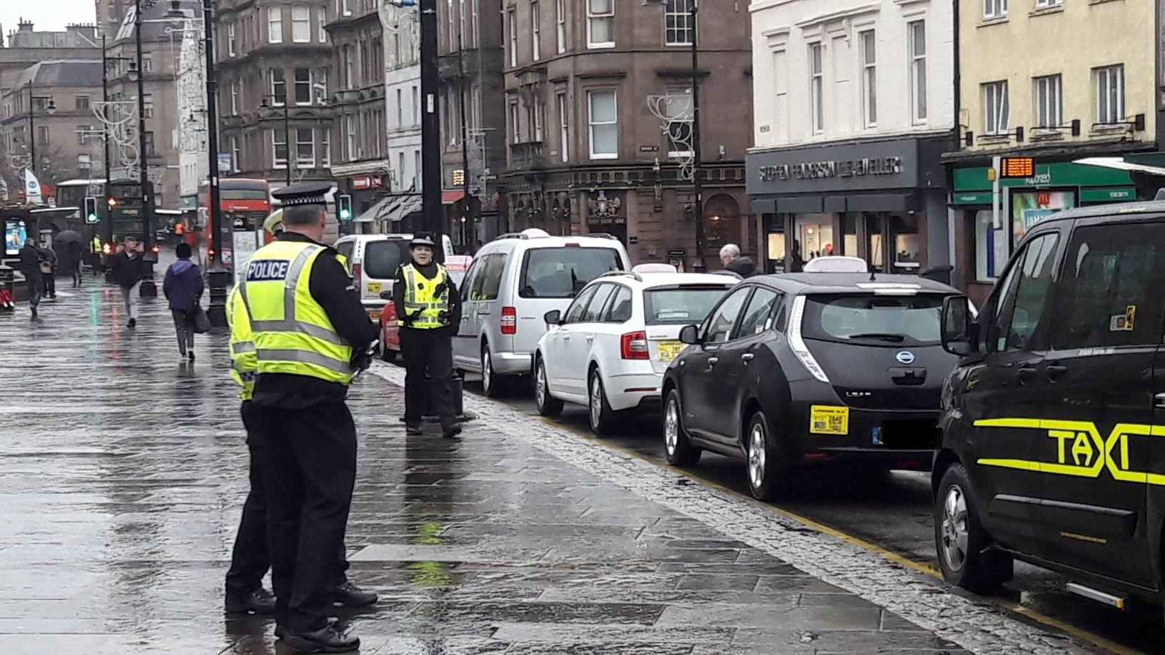 Police on their inspections of taxis in Dundee city centre
