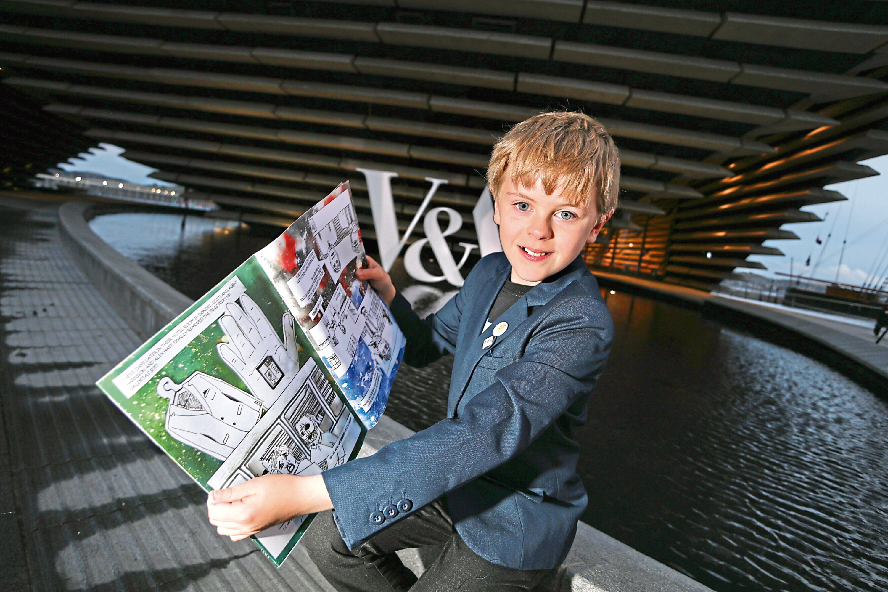 Drew Marr with his latest comic beside the V&A.