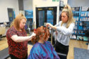 Tele reporter Amy Hall gets styled up at Freedom Hair hairdressers Erin Mitchell and Claire Murray