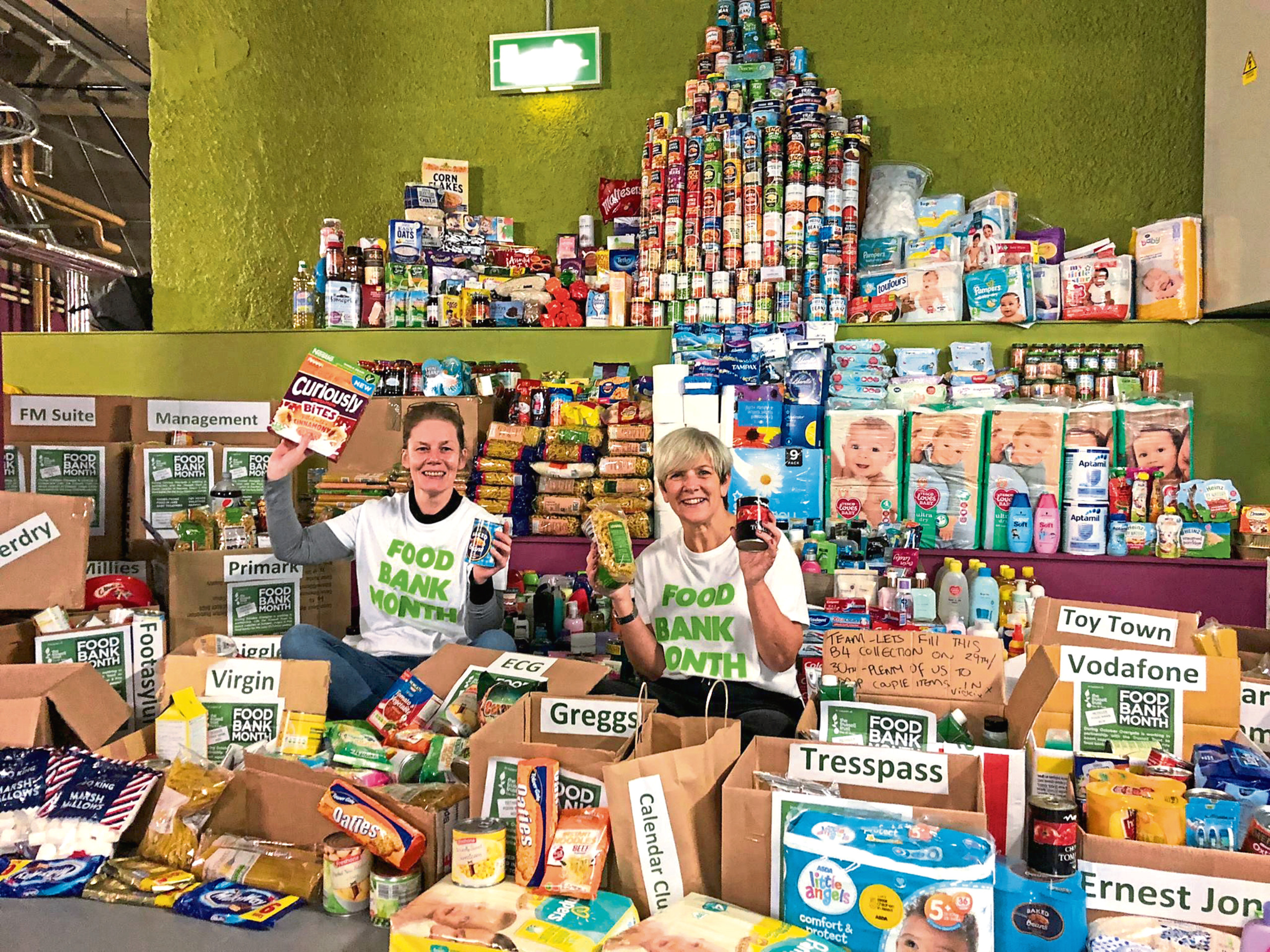 n Picture shows Morag (left) and Karen Michie, an administrator at the Overgate, with the haul of items. These will now be donated to food banks in Dundee, Angus and Fife.