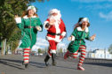 Garry Smith as Santa and Sherridan Duffy and Michelle Bruce as helpers