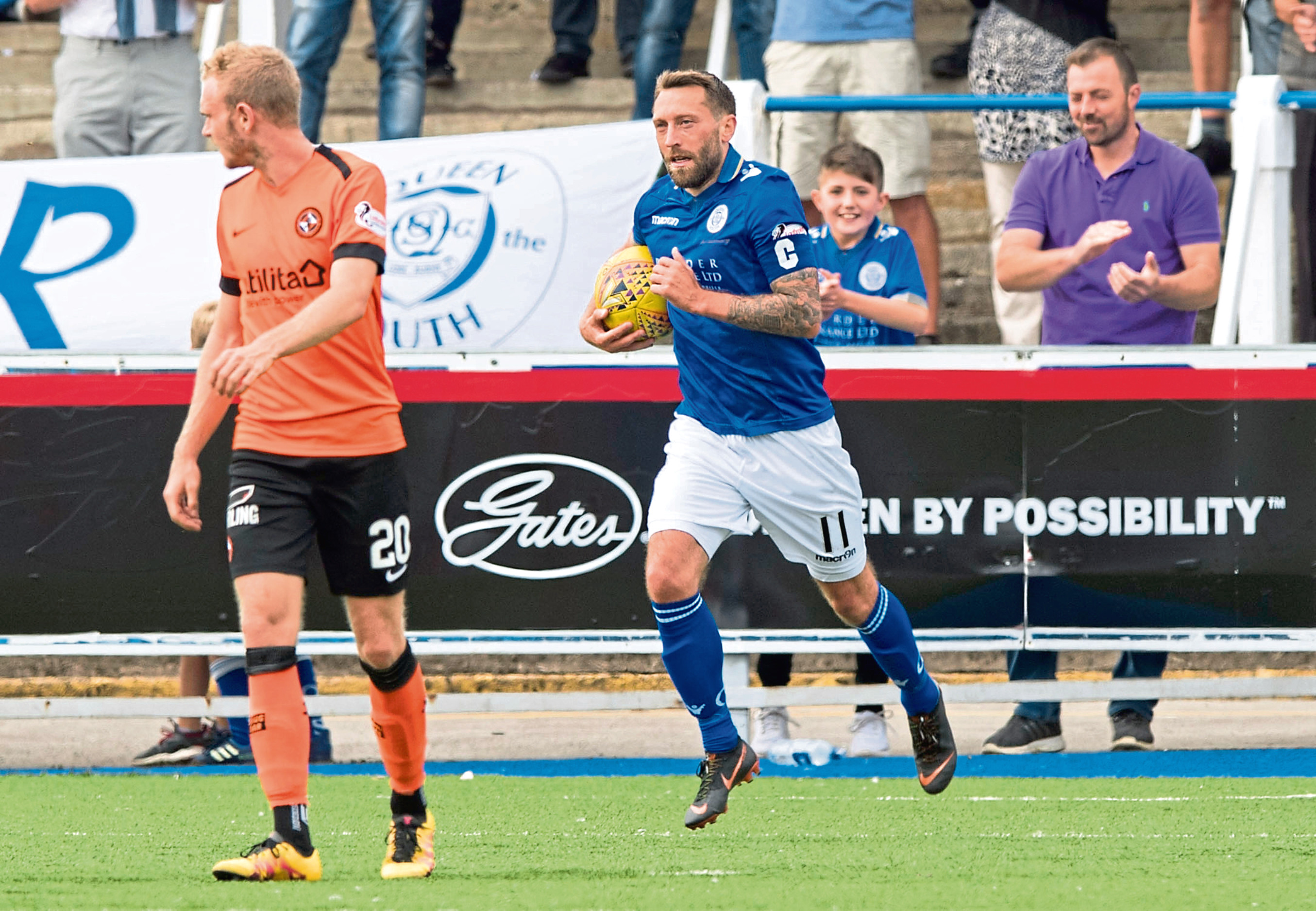 Queen of the South's Stephen Dobbie celebrates scoring against Dundee United in August