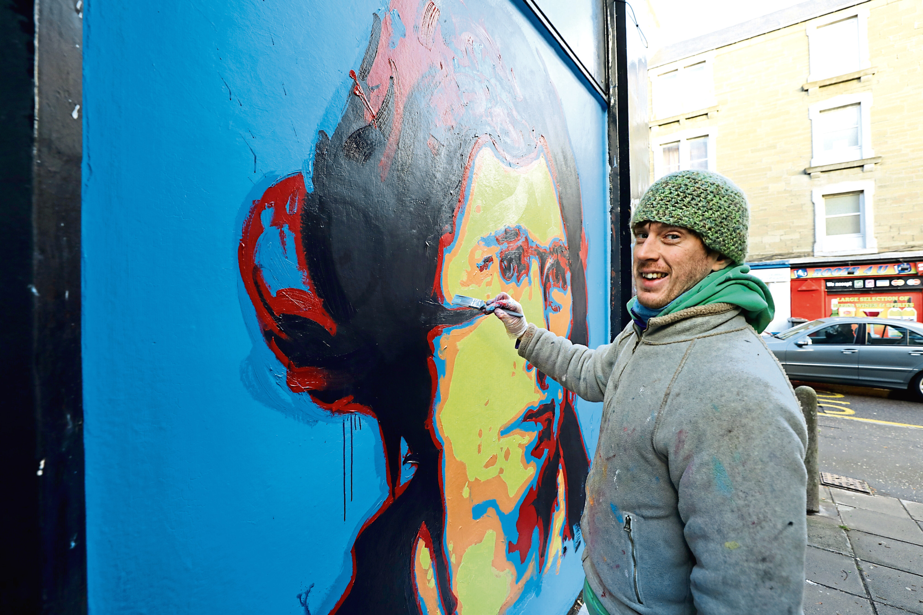 Michael Corr painting his mural of Ethel Moorhead, in a close off Langlands Street in Dundee