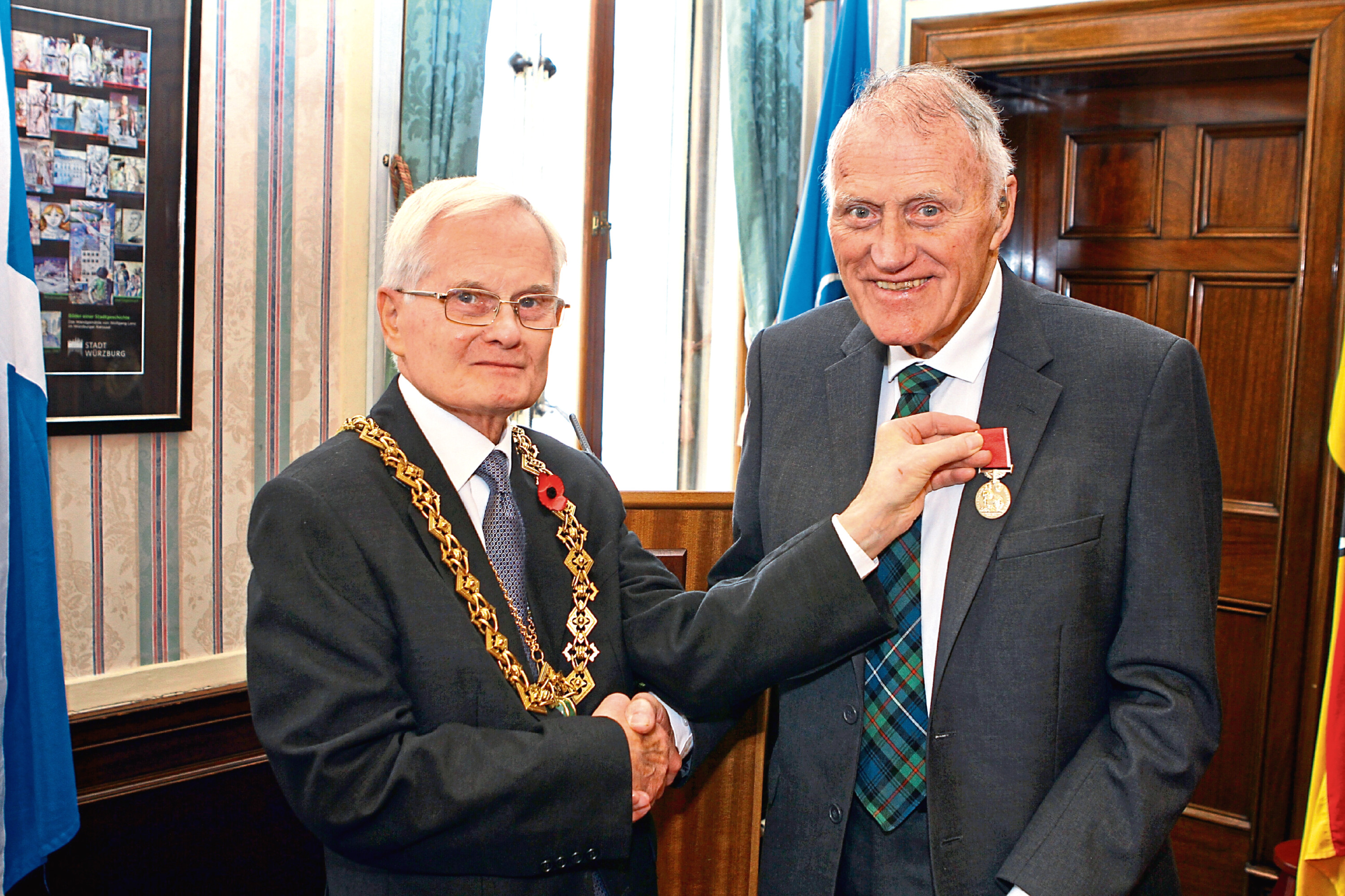 Frank Jordan receives the British Empire Medal from Lord Provost Borthwick at a ceremony for family and friends in the city chambers