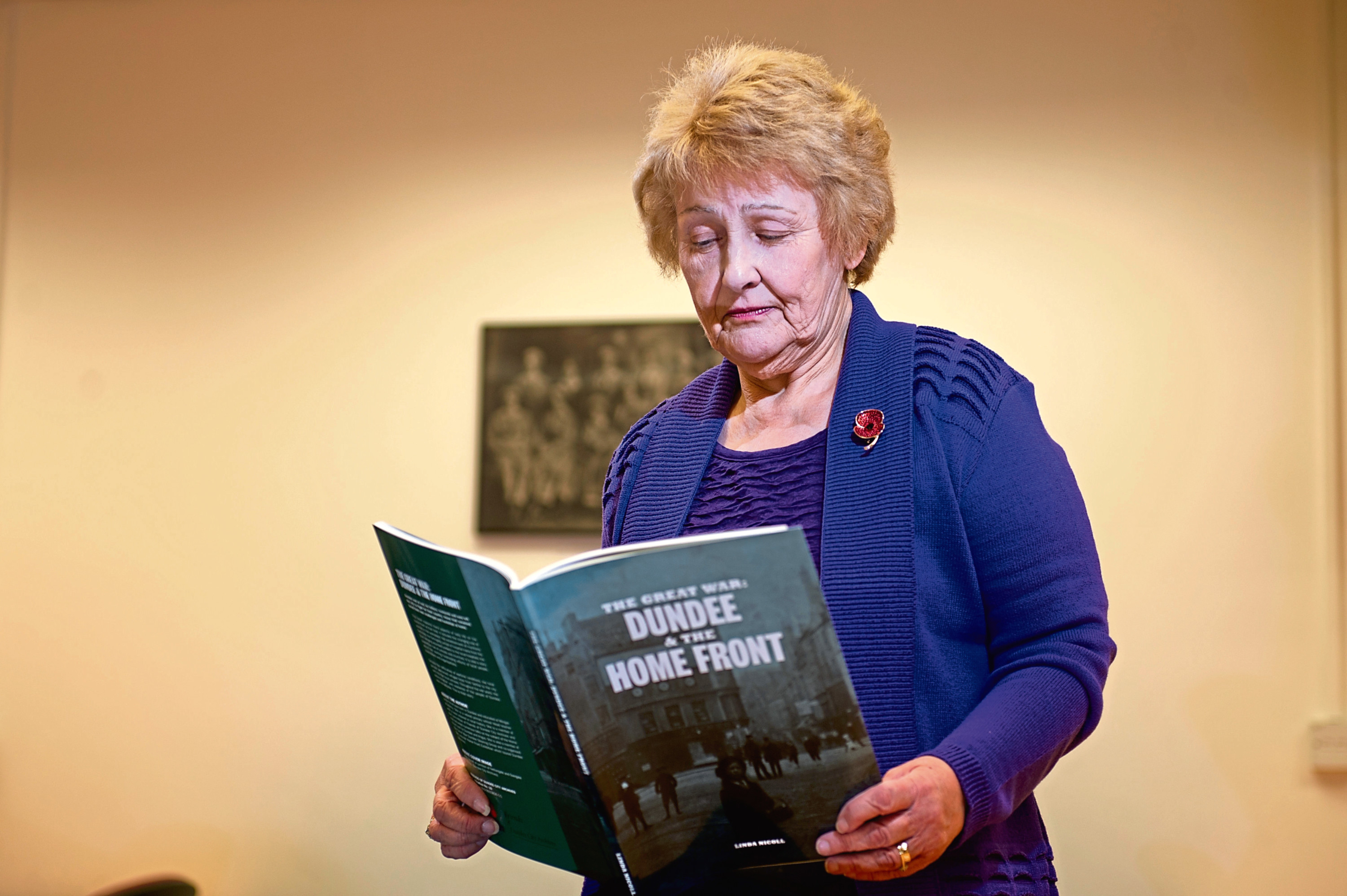 Linda Nicoll with her new book at Dundee City Archives